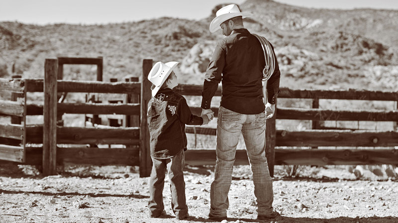Father and Son Wearing Handmade Cowboy Boots